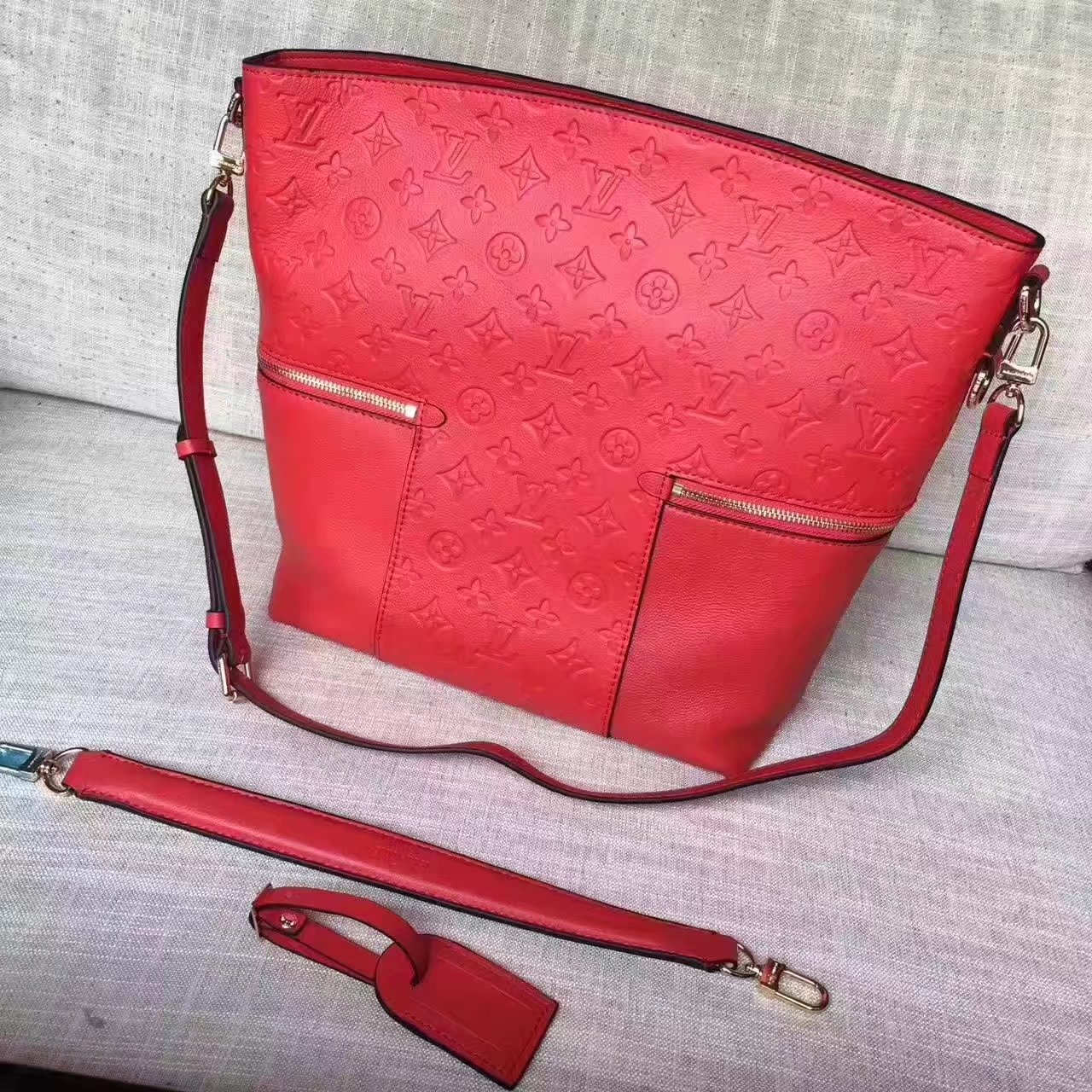 Louis Vuitton M44013 Melie Monogram Empreinte Leather Cerise